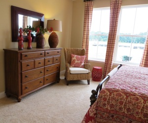 Red, tan and cream bedroom