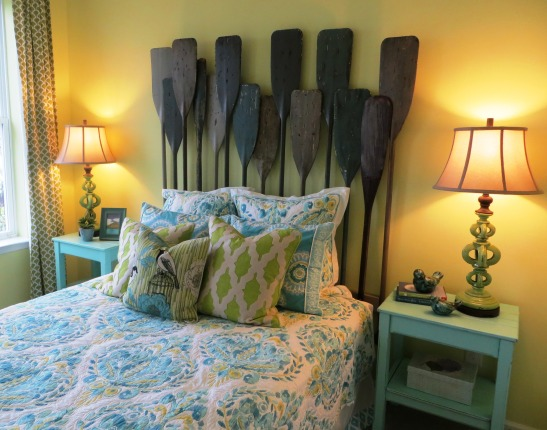 Blue and green bedroom, oar headboard